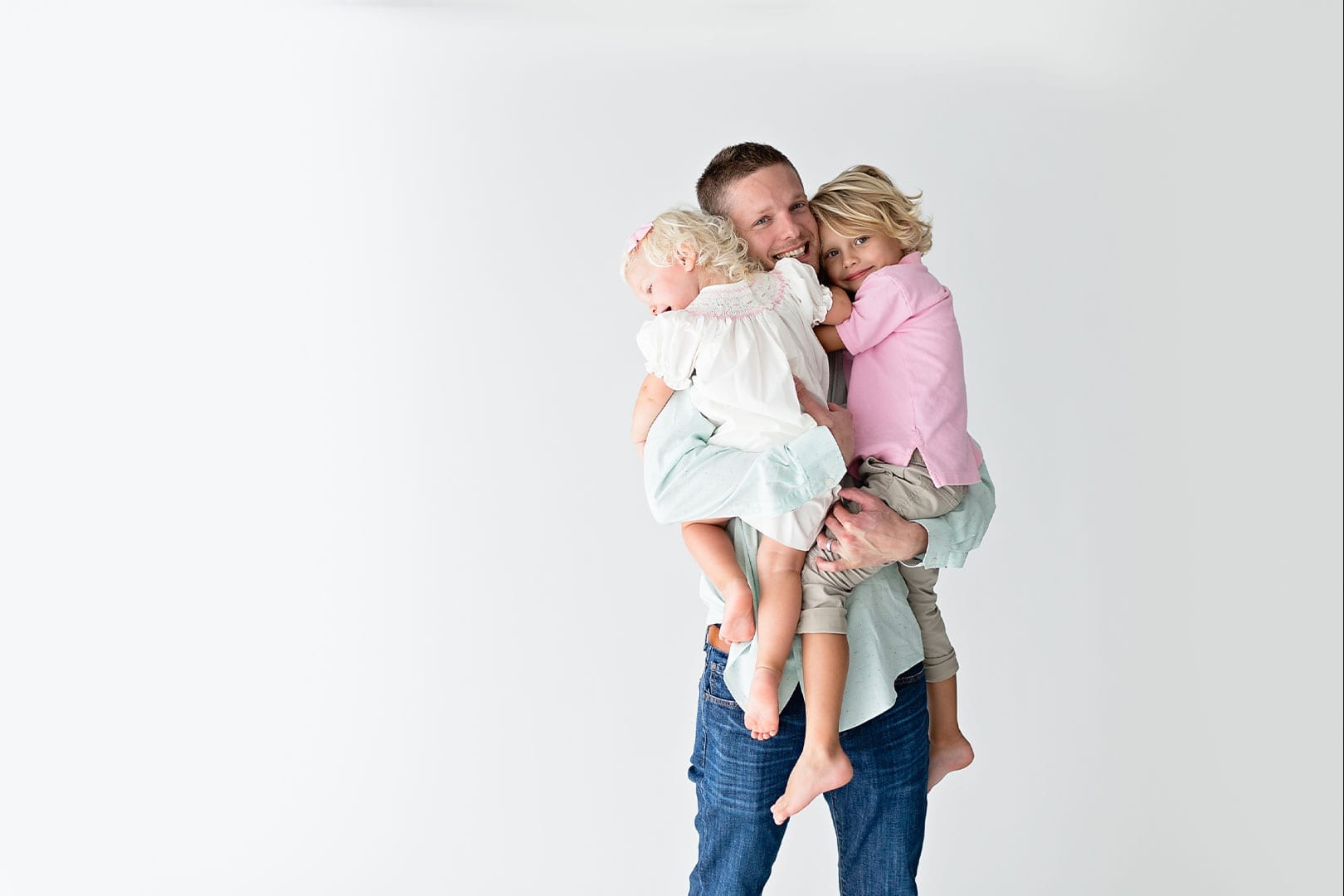 Man carrying the two children