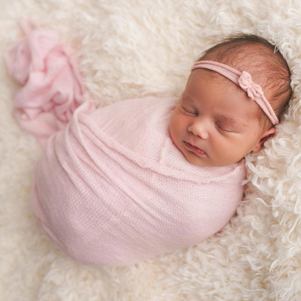 sleeping baby cover with pink cloth and headband